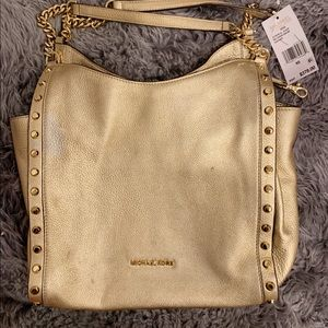 A Micheal Kors Shoulder Bag Golden color